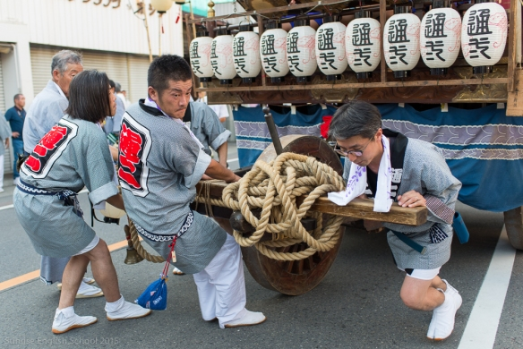 Men pulling a Dashi festival float.