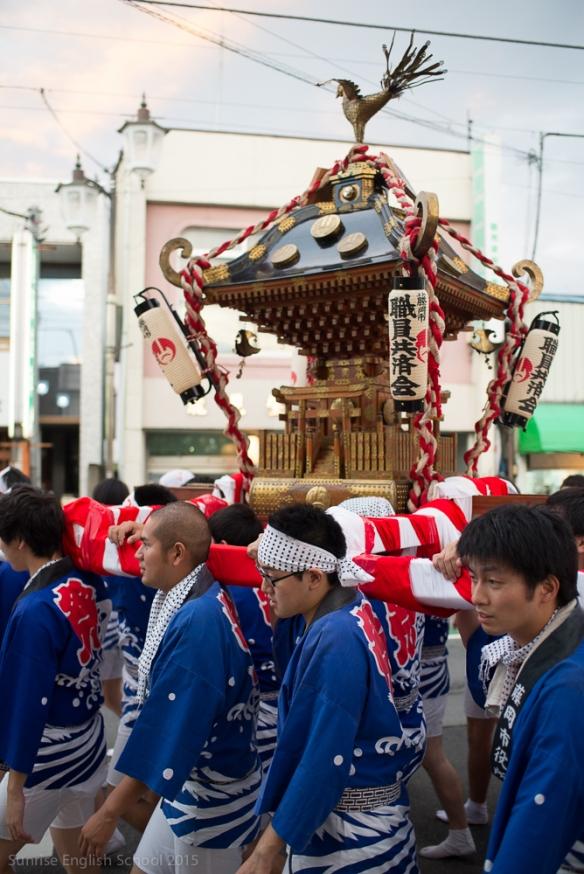 Men carrying a Mikoshi portable shrine.